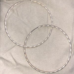 Jewelry - Silver hoop earrings with detail
